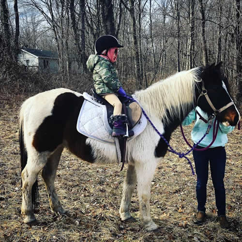 Ryan Leigh Dostie's daughter riding a horse