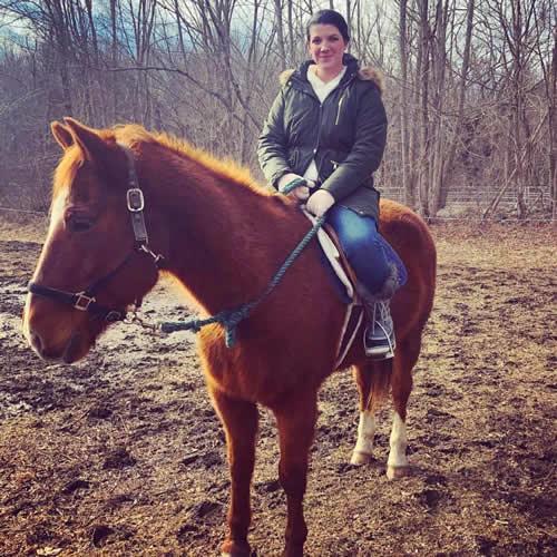 Ryan Leigh Dostie riding a horse